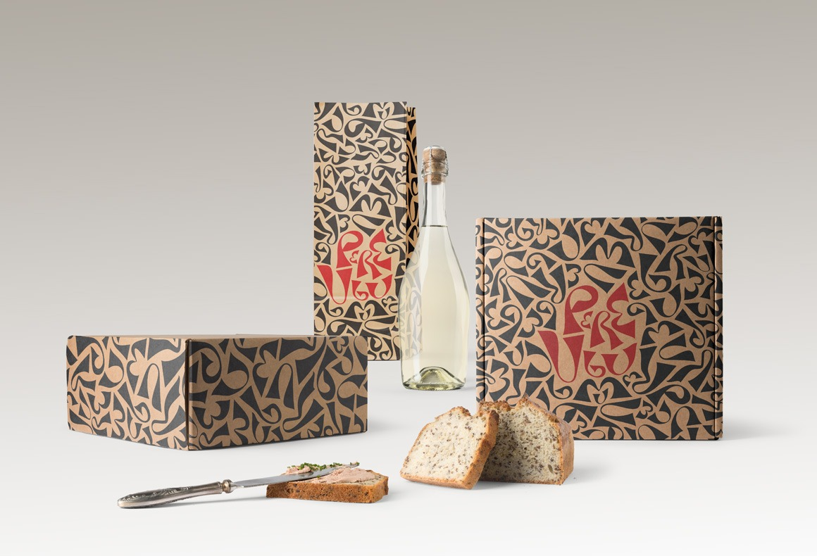 Restaurant food packaging designs with a red and black logo pattern on craft paper.