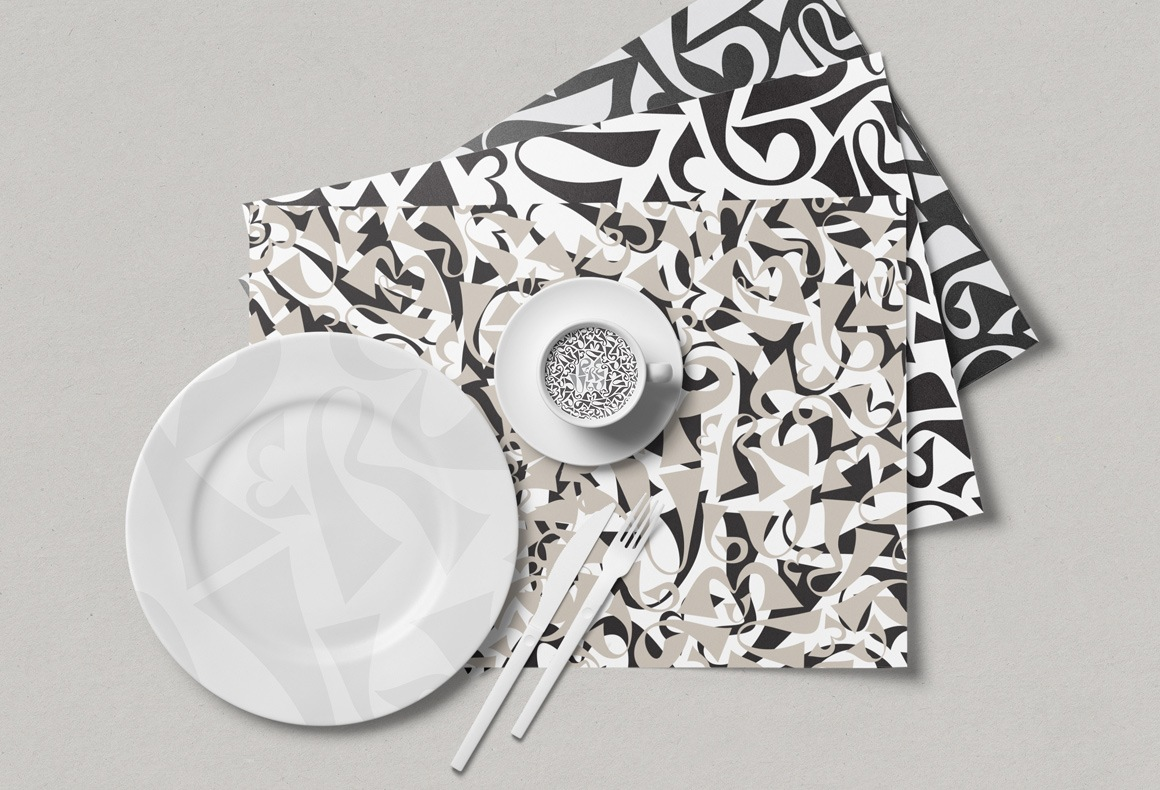 Branded collateral including placemats and customized plates for Pere Ubu restaurant.