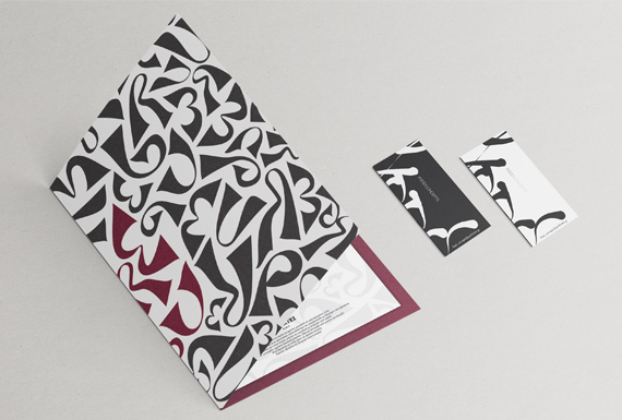 The brand identity design for Pere Ubu restaurant based on a letterform pattern in a black, white, burgundy scheme.