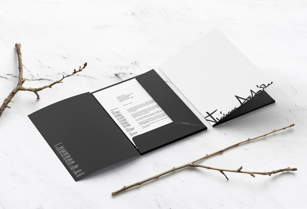A black and white folder design for the visual branding of Deloudis.