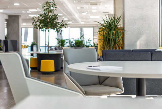 A closeup view of Exness's informal meeting area, with a motivating work environment in the background.