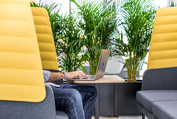 Yellow and grey booth seating by Narbutas creating a private informal meeting space.
