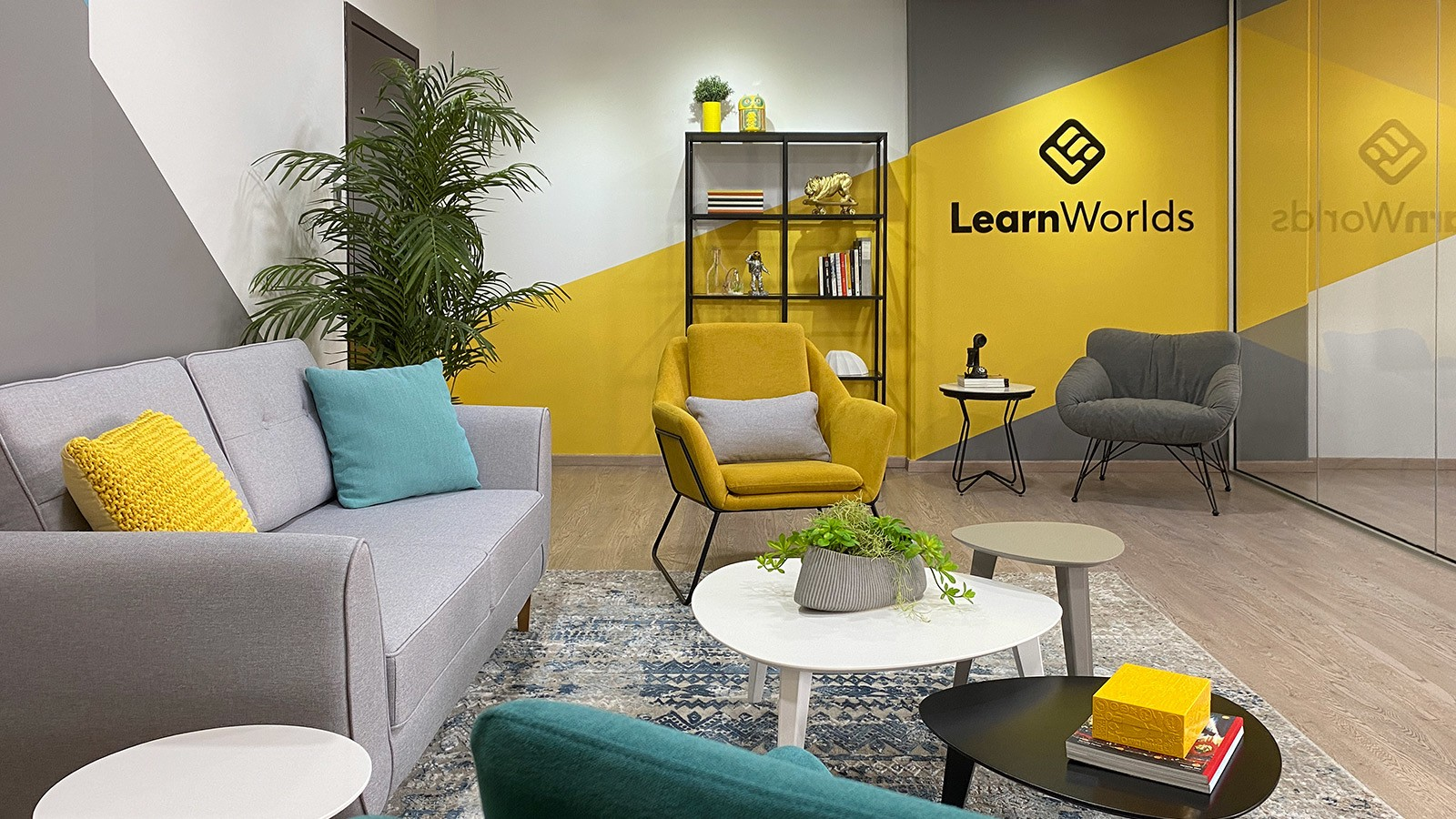 A fresh, hip and youthful design with modern furniture and a diagonally painted accent wall for Learnworlds tech office.