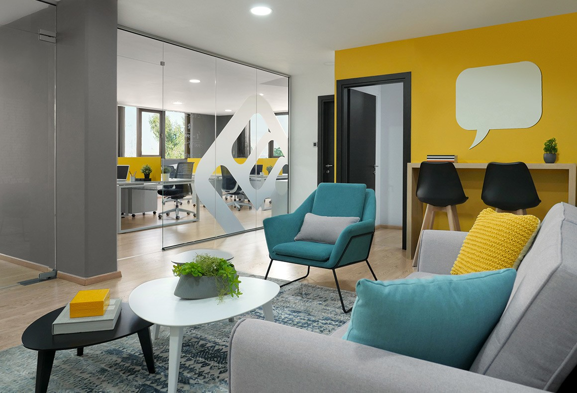 A colorful and hip interior design concept for the lounge of tech company, LearnWorlds.