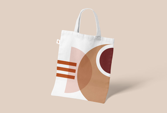A custom tote bag designed for Diotima Cultural Institution with a geometric design in warm earthy tones.