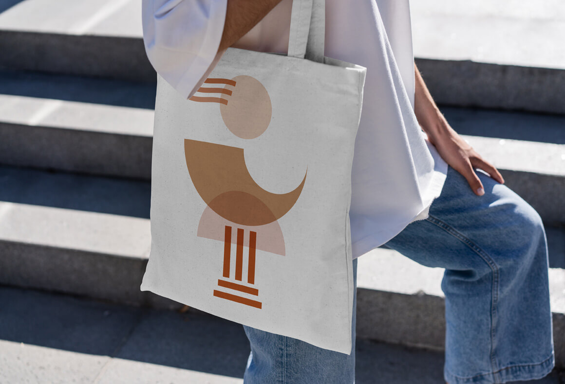 A branded tote bag for Diotima Cultural Institution with their logo which is an abstract ancient female figure.