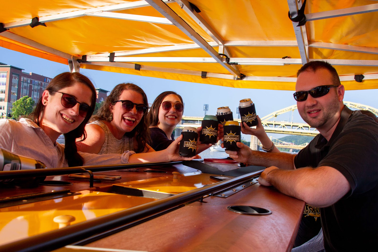 a group of adults drinking beer on a boat