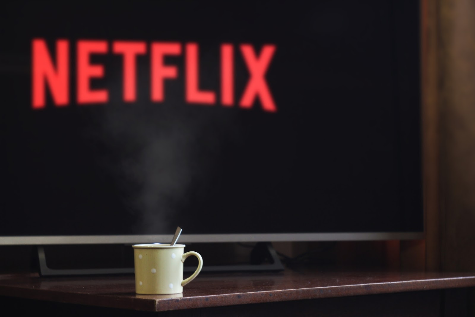 mug in front of TV with Netflix on