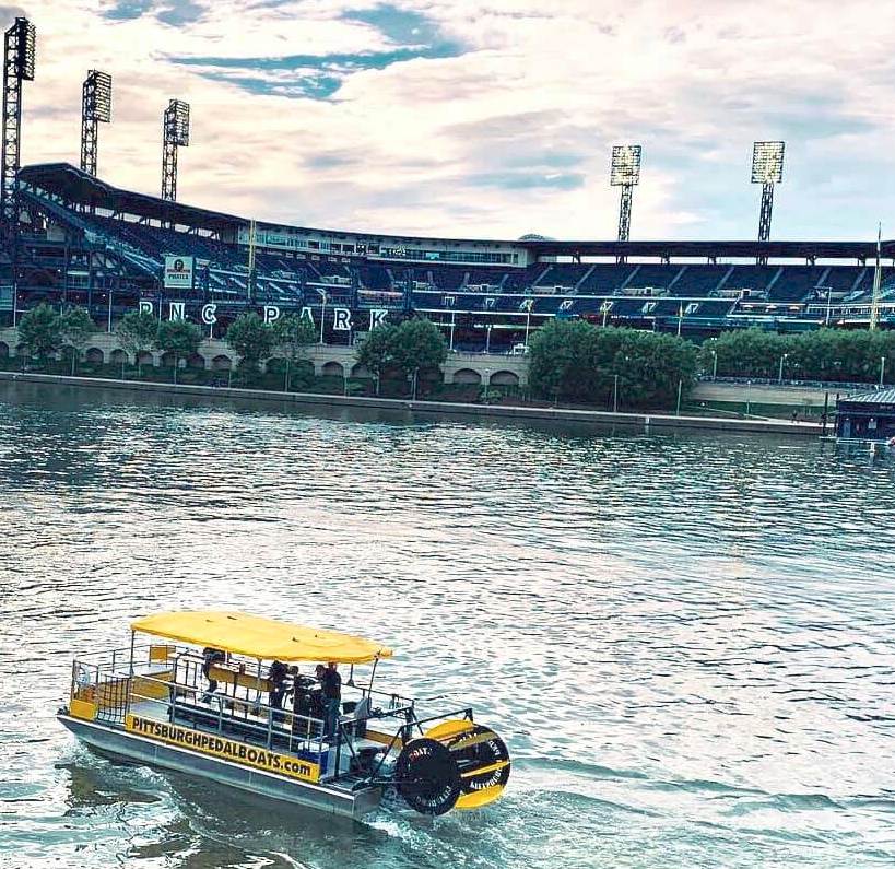 pittsburgh pedal boat sailing past PNC park