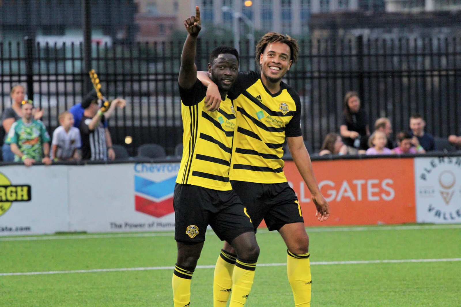two members of Riverhounds soccer team