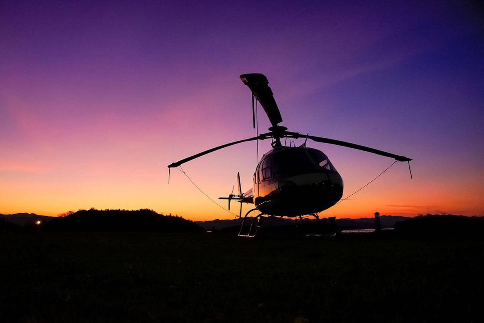 helicopter in front of a sunset