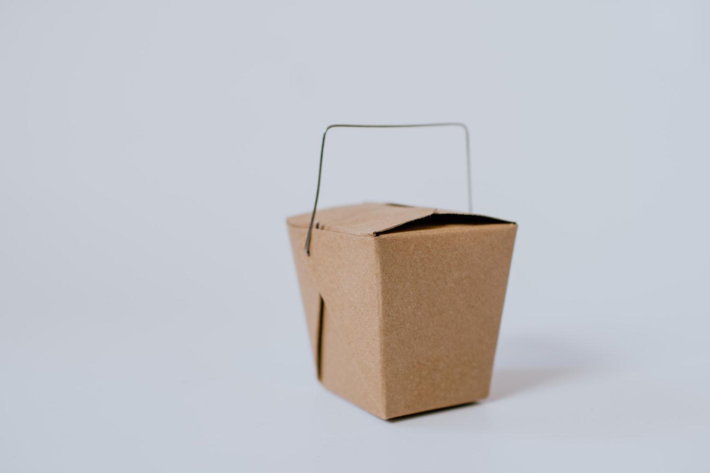 Closeup studio photo of a takeout box.