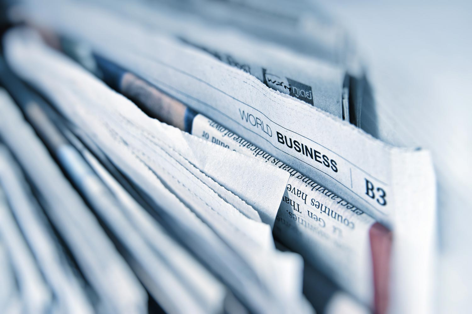 Closeup photo of a bunch of newspapers.
