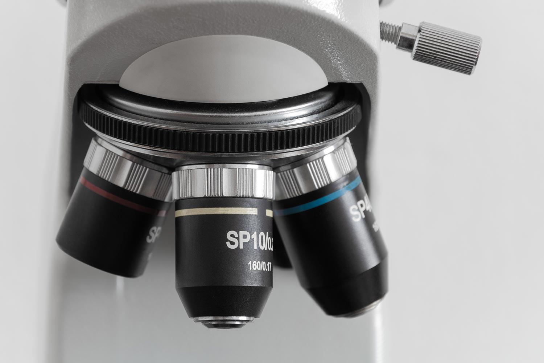Closeup of a microscope's lenses.