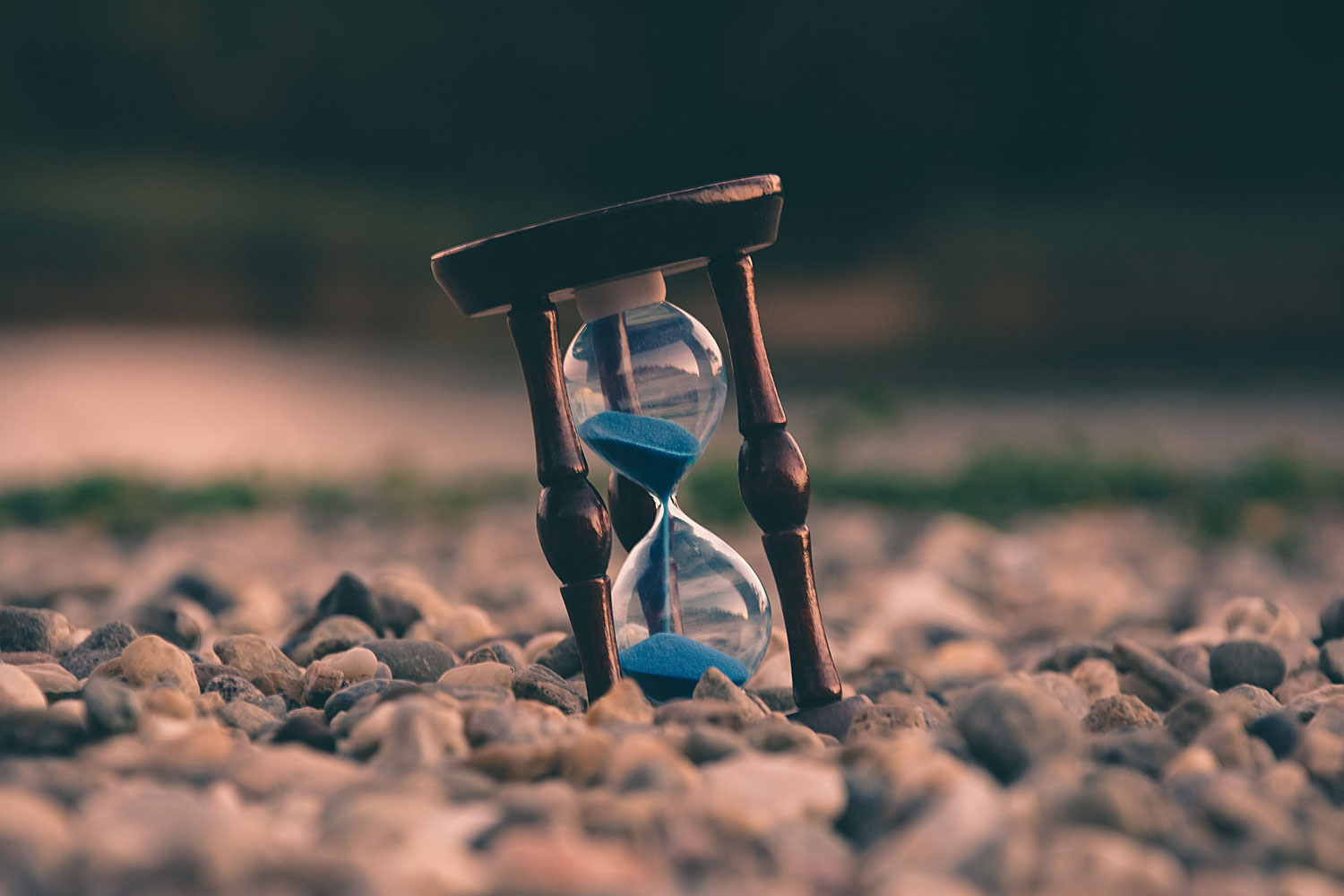 Photo of an hourglass on the beach.