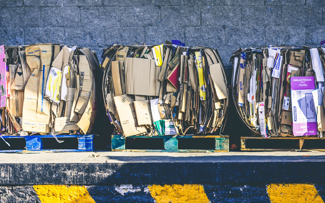 Photo of boxes of cardboard lined up ready to be recycled.