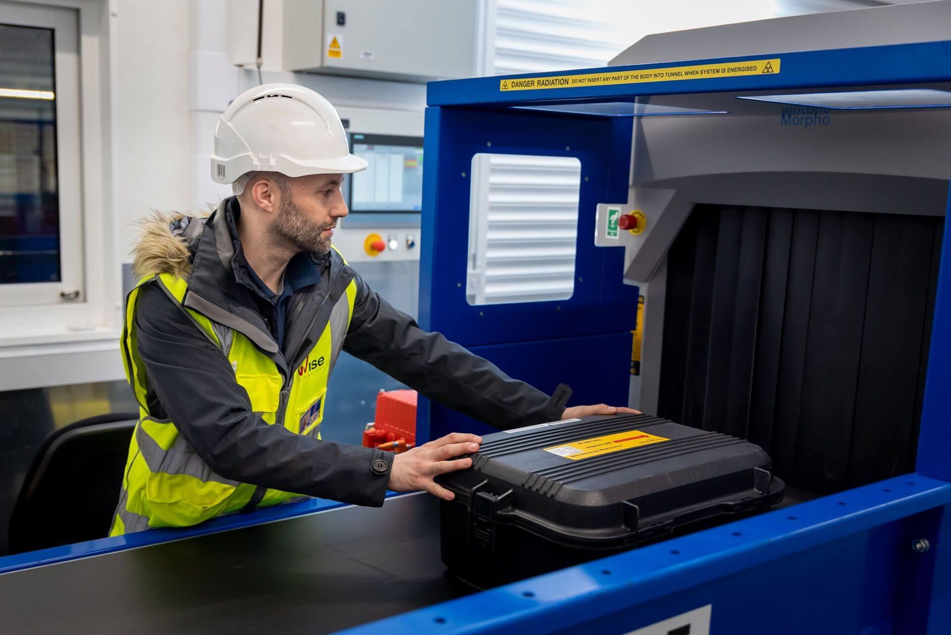 Engineer working on baggage scanner