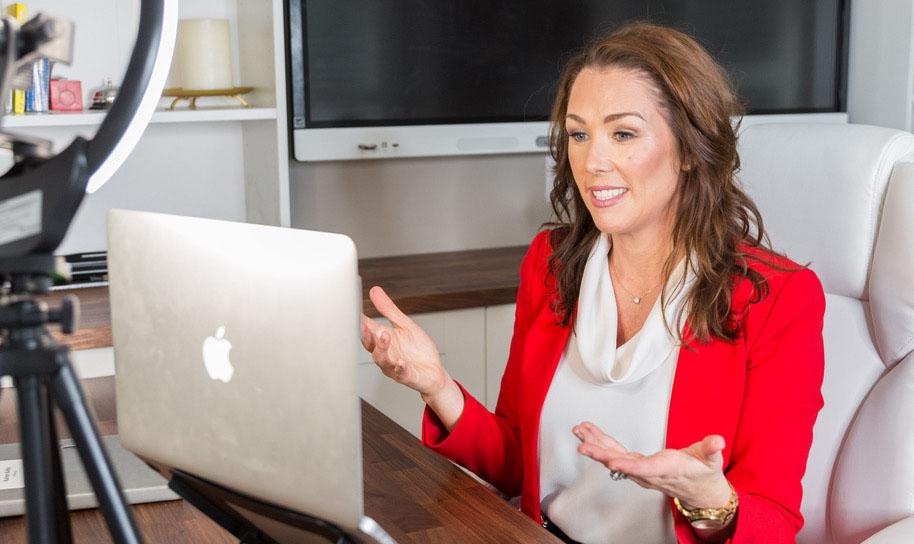 Photo of Karen doing a video call