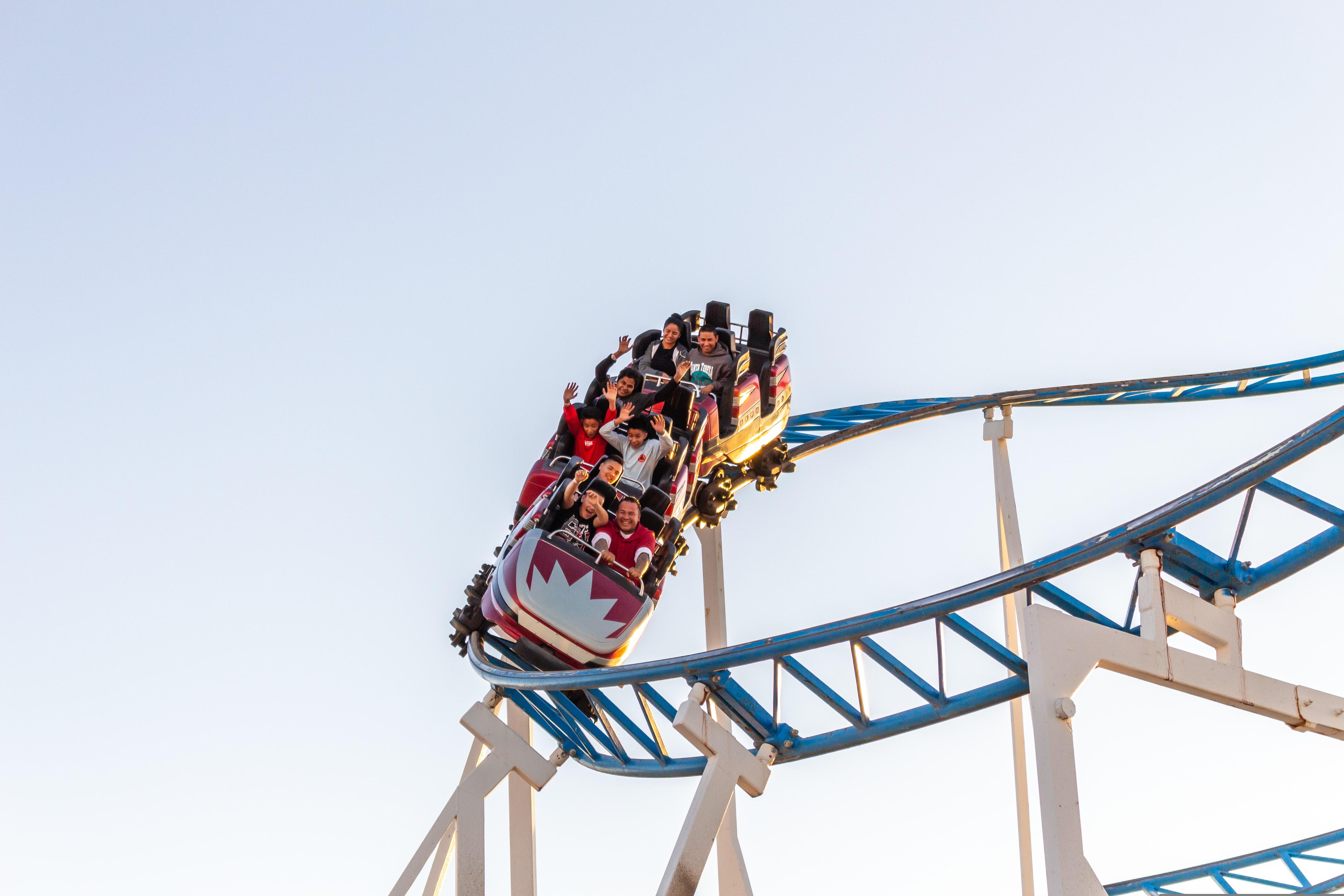 Teenagers having fun on roller coaster