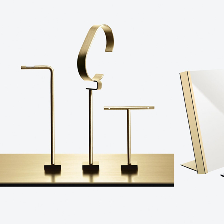 Jewellery displays in gold with magnetic bases for visual merchandisers
