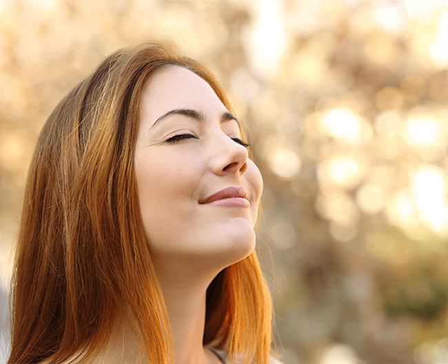 Woman enjoying deep breaths