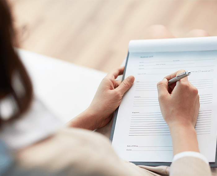 Woman filling out financial paperwork