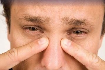 Man suffering from sinus blockage
