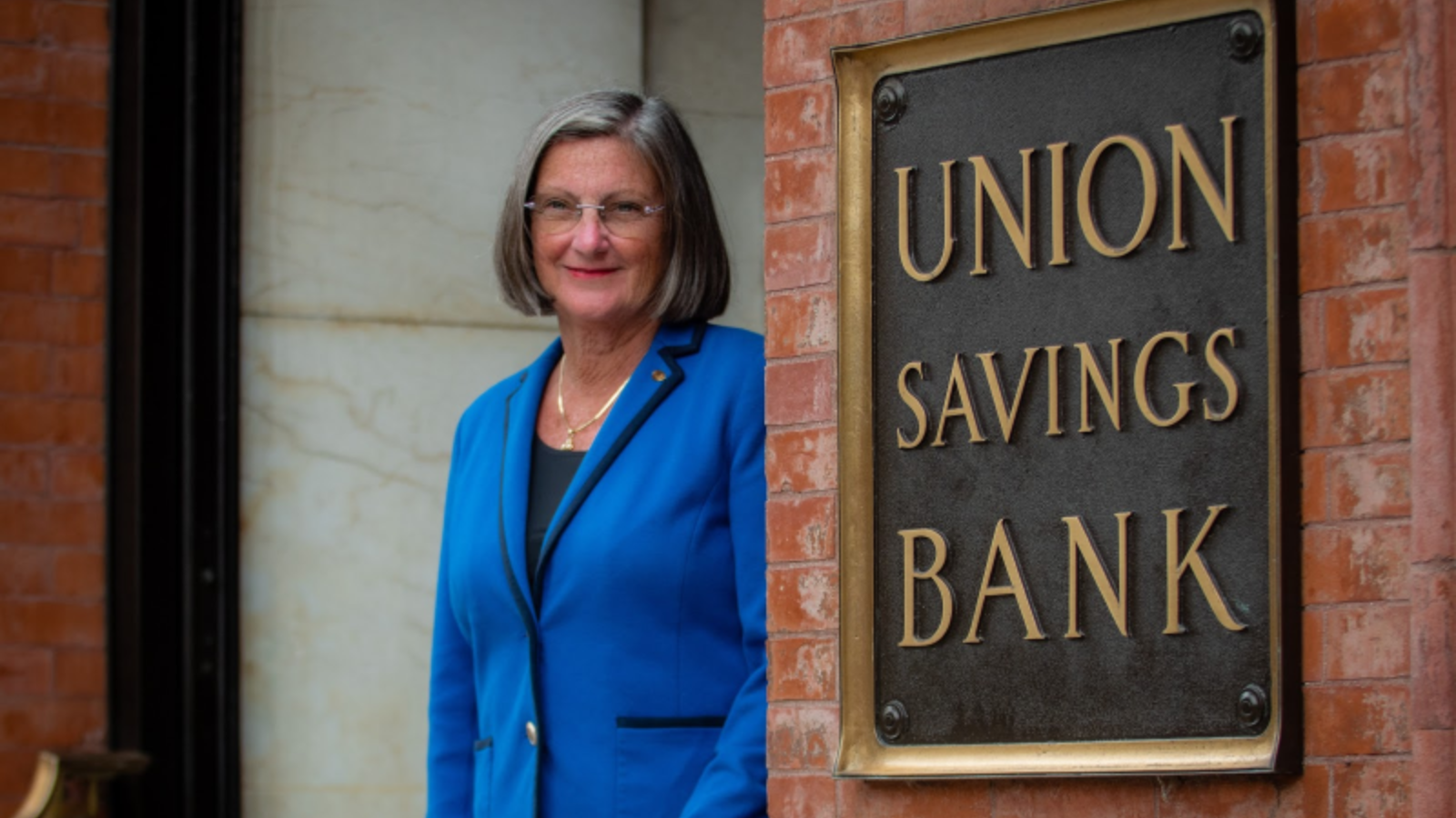 Cynthia Merkle standing in front of Union Savings Bank