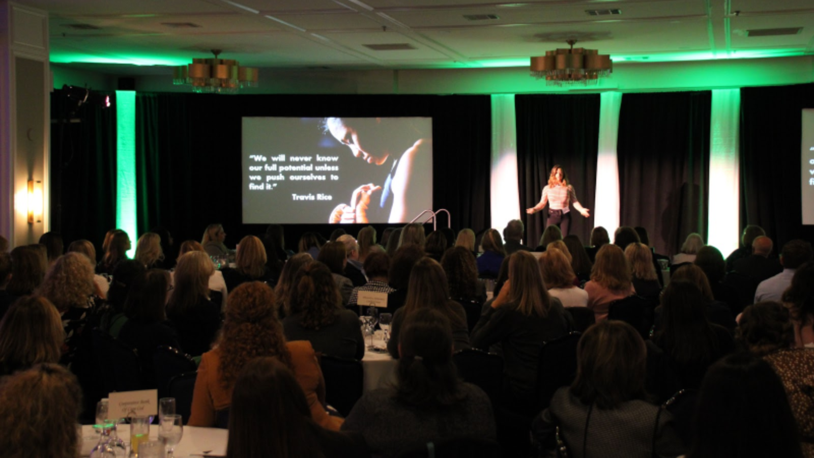 A presenter gives her speech at New England Women in Banking Conference