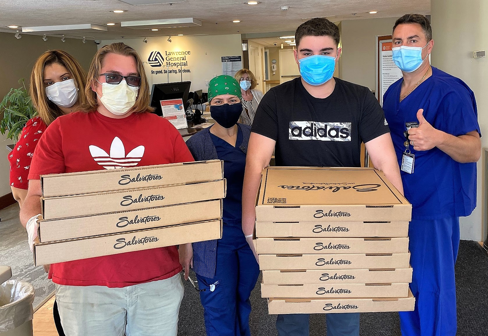 "Merrimack Valley Credit Union and members contributed $15,000 through its ""Feed the Frontline"" program to purchase 1,700 meals from seven local restaurants for the hardworking healthcare professionals at Lawrence General Hospital. Pictured above, employees from Salvatore's in Lawrence deliver 130 pizzas to staff at Lawrence General Hospital."