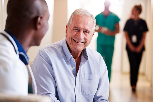 A man talking to his doctor.