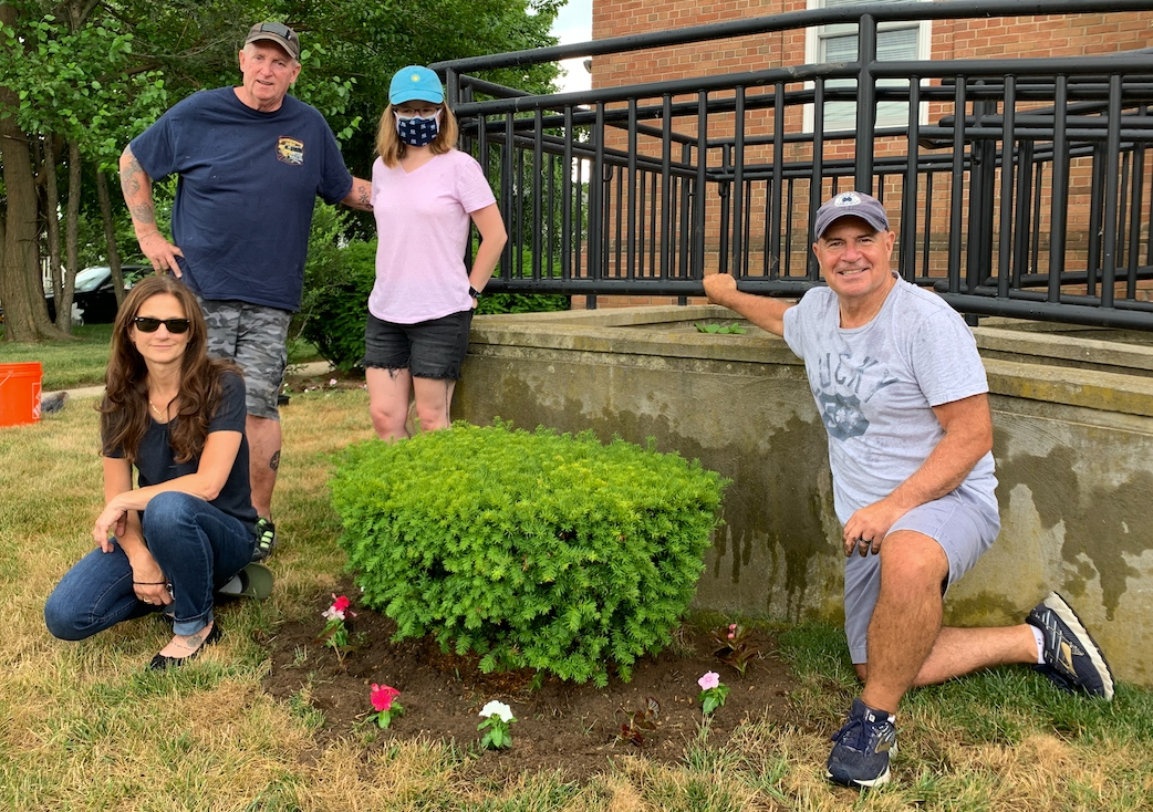 Ocean Financial Federal Credit Union staff plants flowers