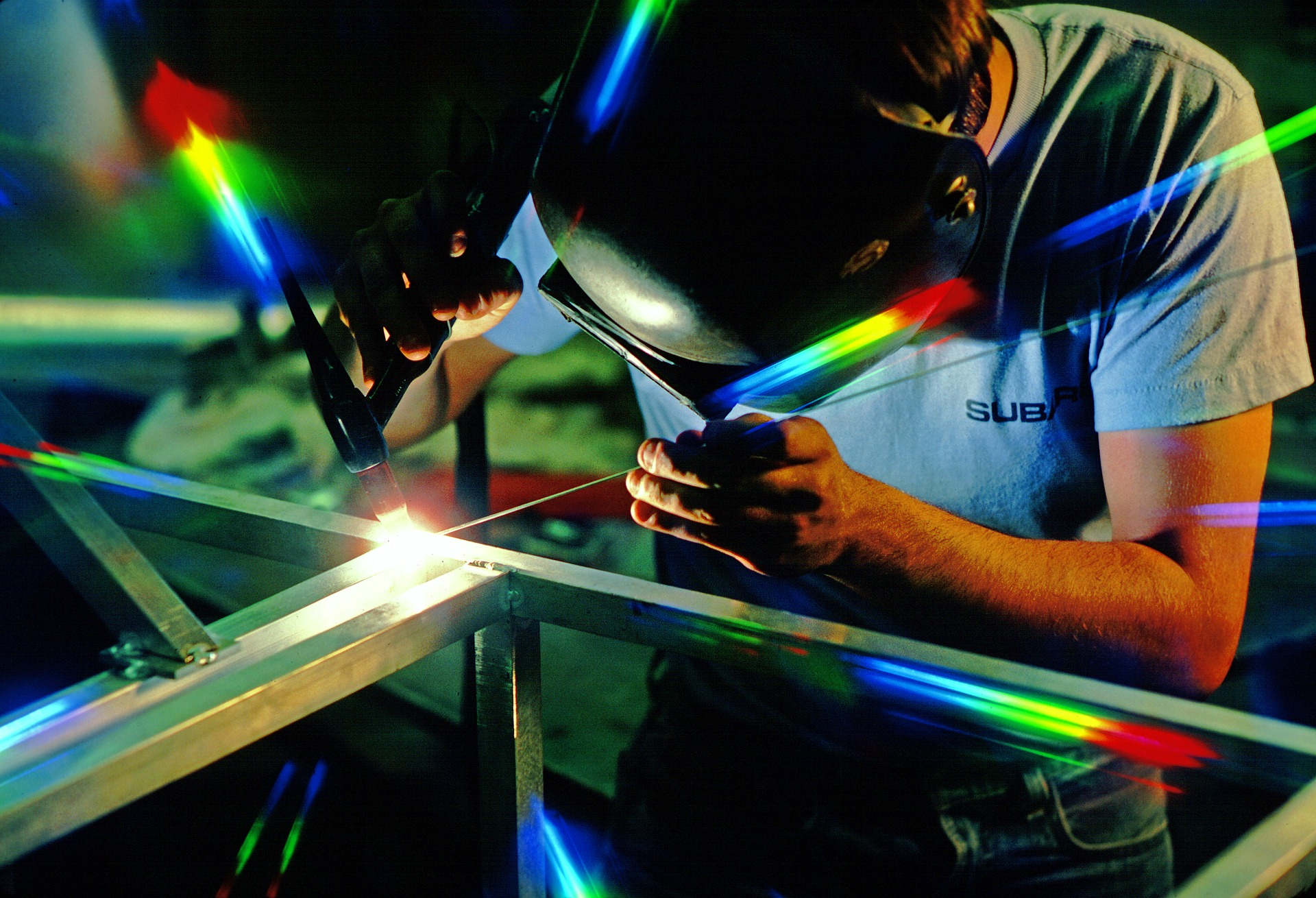 Welder at manufacturing facility   Image by Mike Flynn from Pixabay