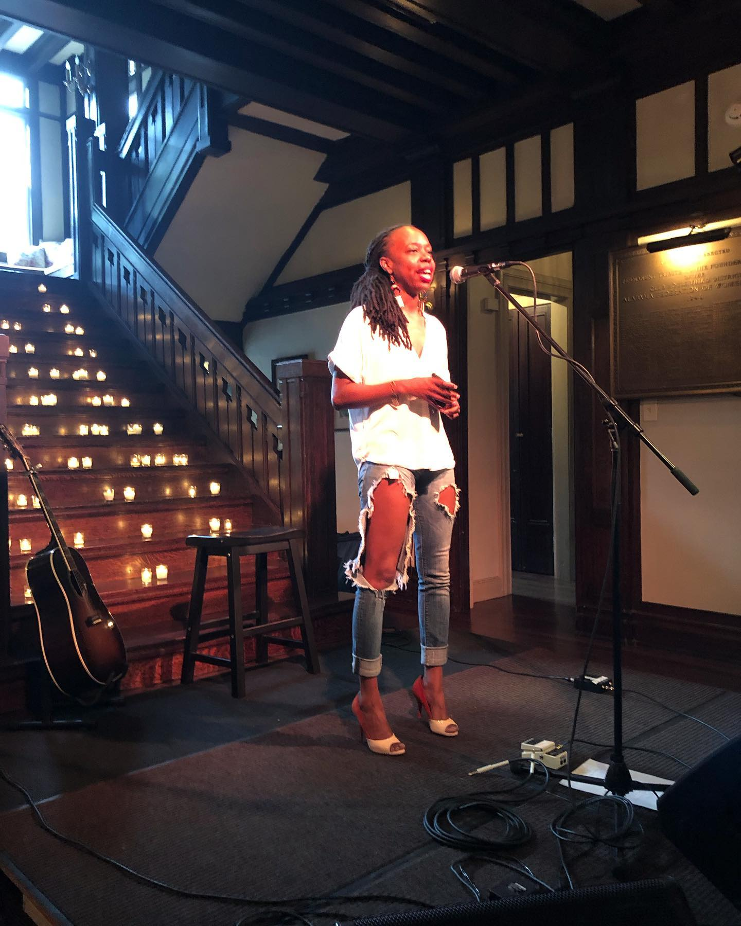 Deidre Clark speaks solo on stage and gives a beautiful word at the Clubhouse on Highland in Birmingham