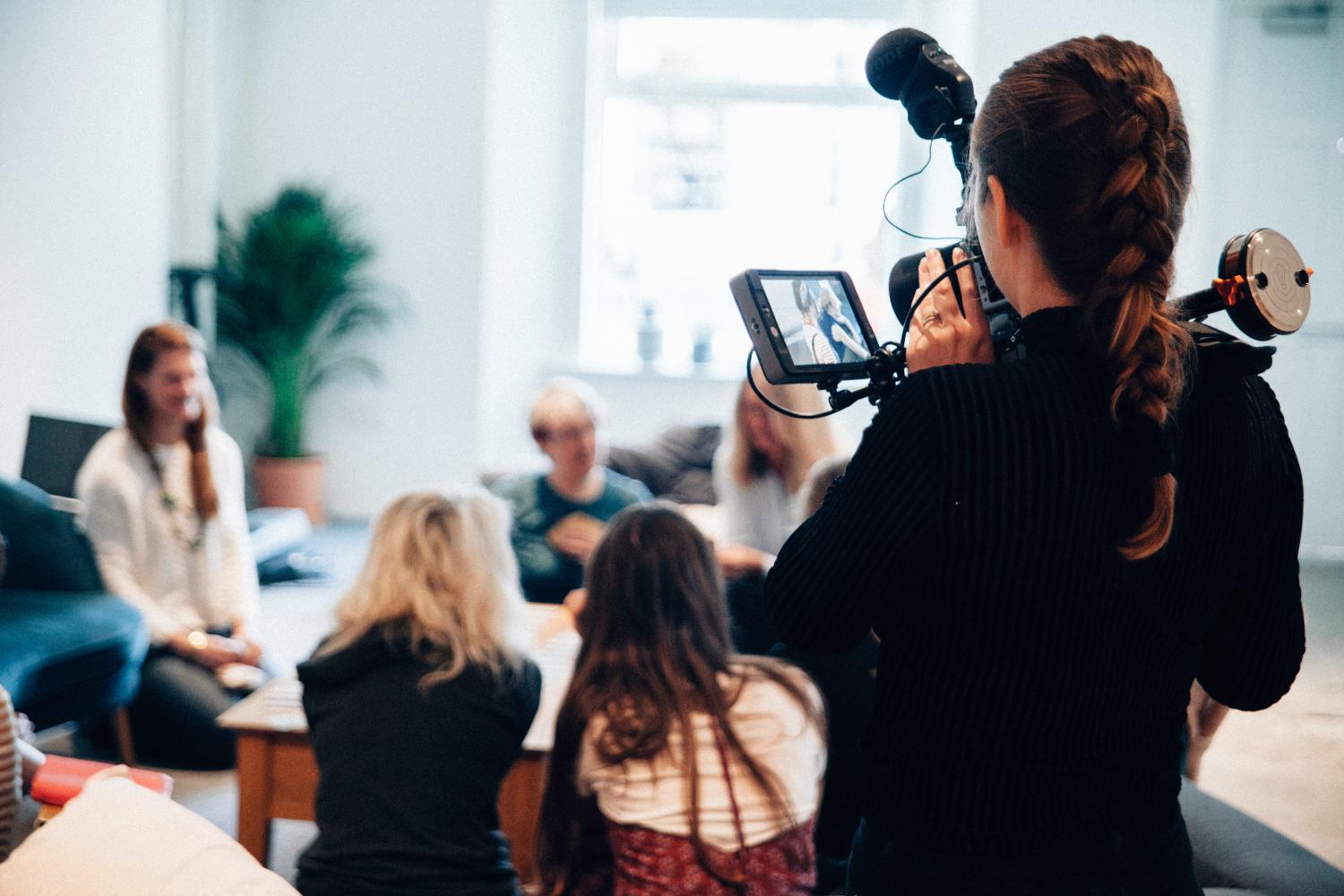 lady filming a class using video camera