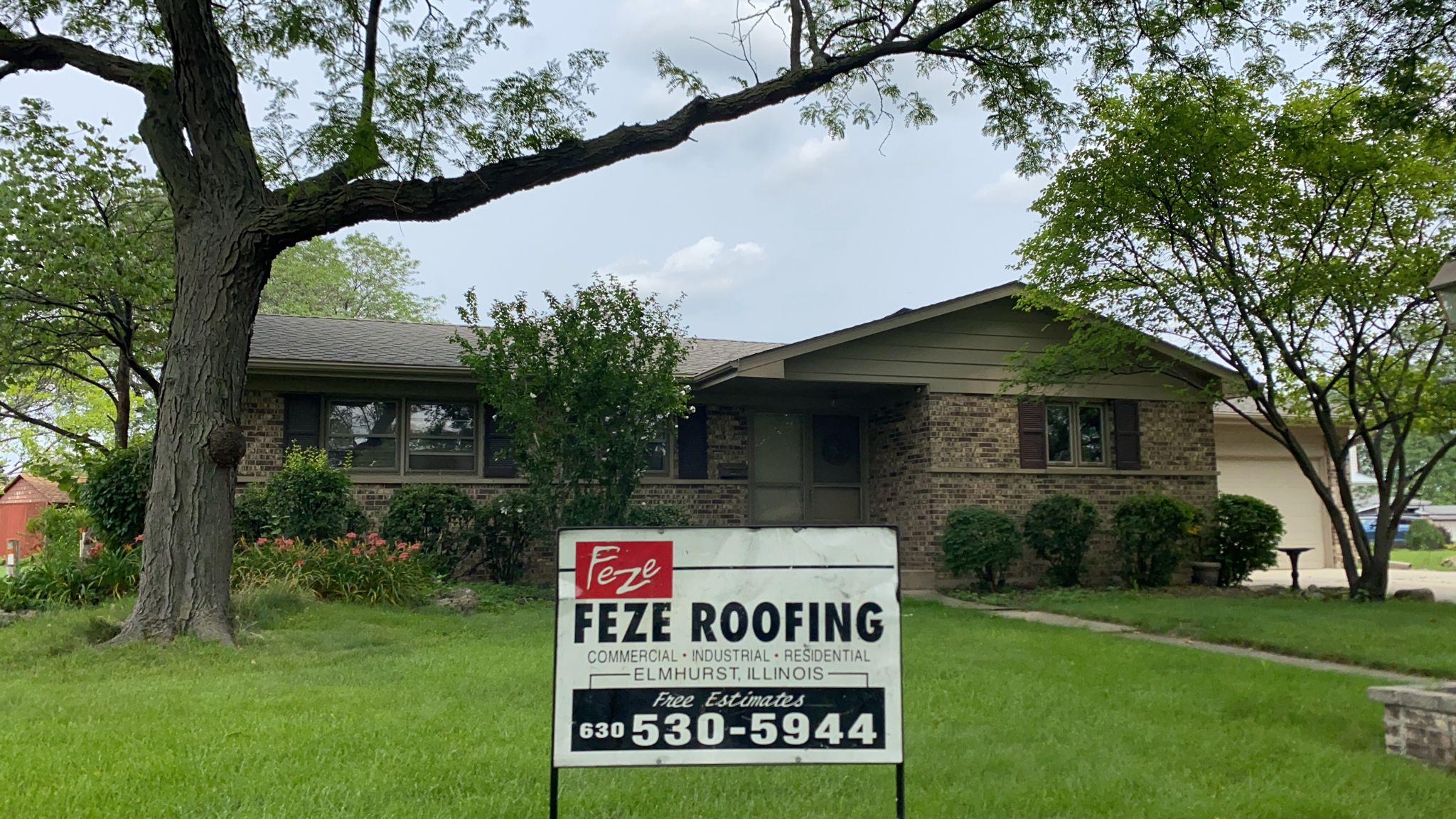 Weathered Wood roof by Feze Roofing Inc. in Elmhurst, IL
