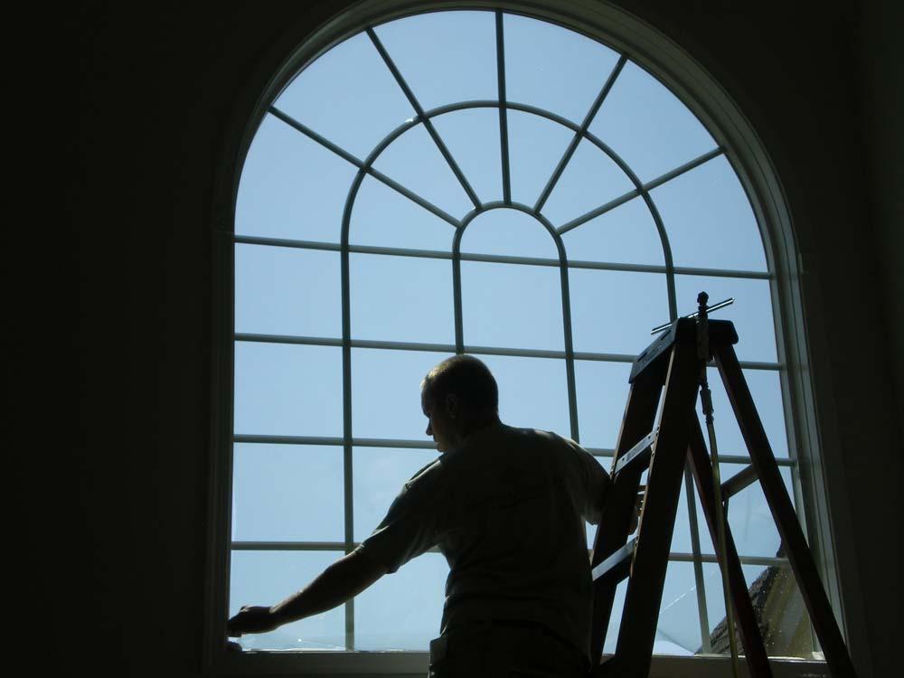 Sun Control Specialist technician installing film in Buckingham, PA