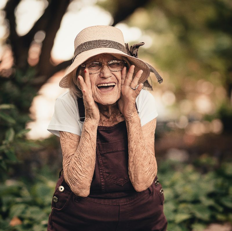 elderly woman in hat smiling