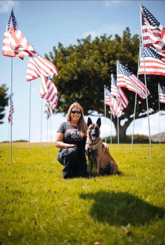 Private Investigator and K9 handler Amy Doerner with one of her detection dogs