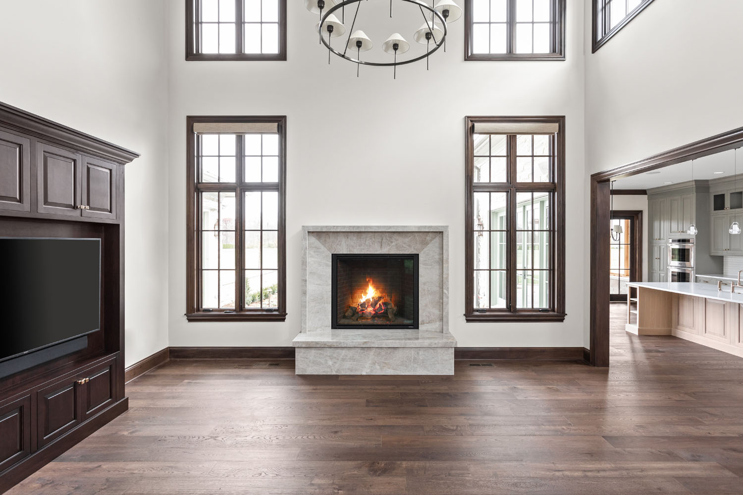 custom kitchen in Indianapolis with dark hardwood floors and high-end stainless appliances