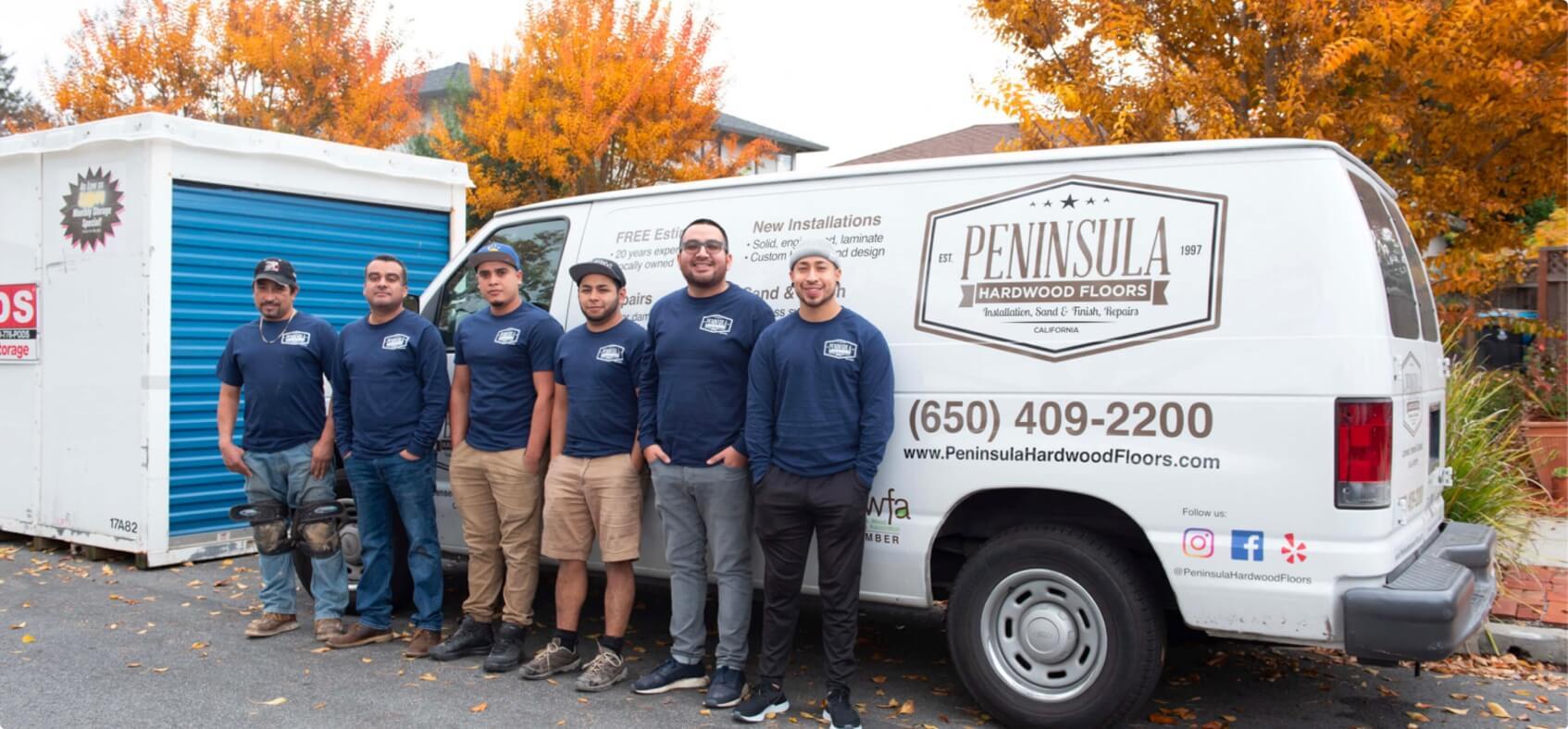 Peninsula team next to van.