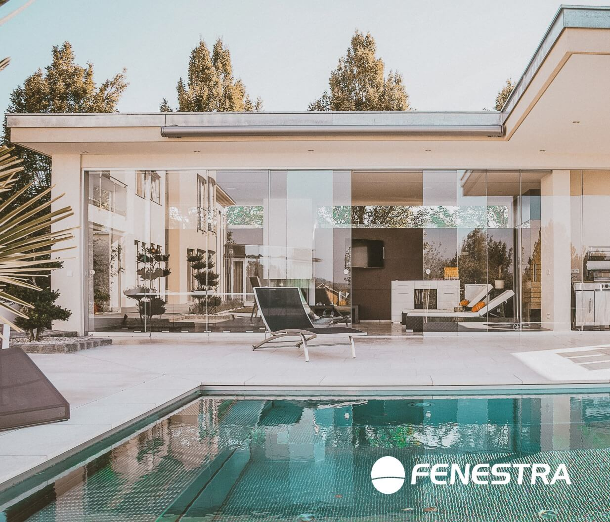 House with a pool and frameless windows with Fenestra logo.