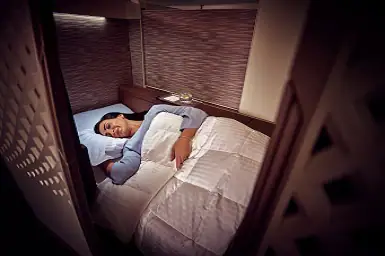 woman sleeping in Etihad First Class