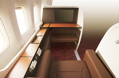 Japan Airlines First Class seat with woodgrain furnishings
