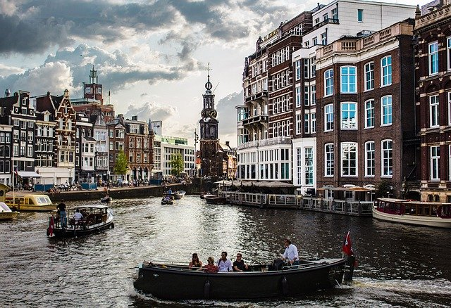 Tourists on a boat ride in the canals of Amsterdam, Netherlands