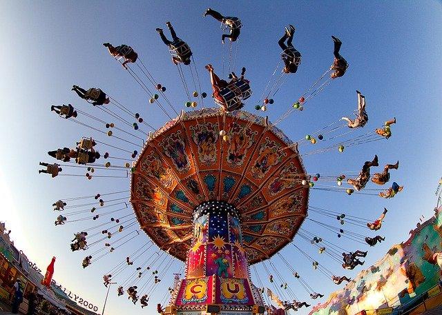 people enjoy the carousel ride at Oktoberfest in Munich, Germany
