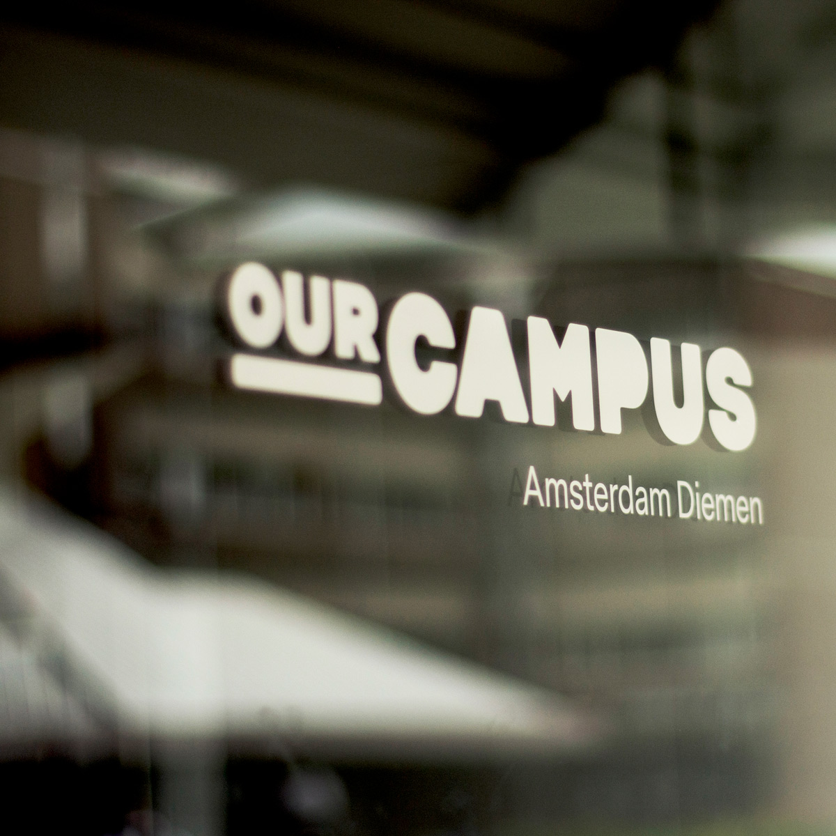 SPX Agency Work: OurCampus logo on the glass