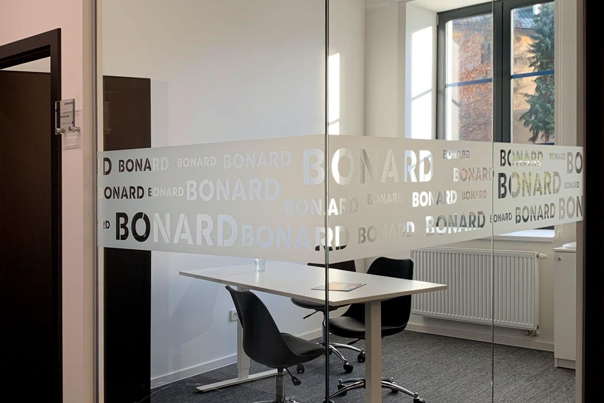 bonard signage logos over glass wall