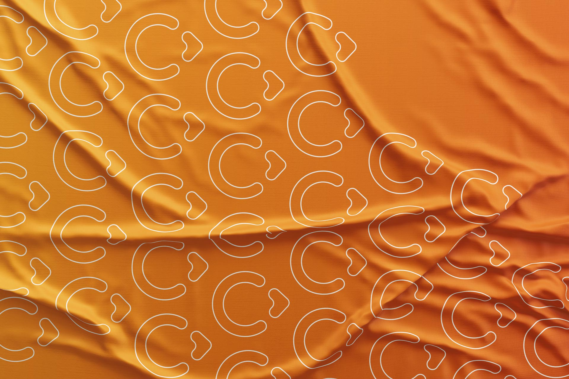 Coliving Ventures logo pattern on an organge cloth