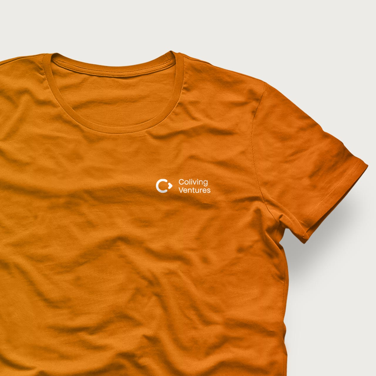 Orange T-Shirt Design with white Coliving Ventures logo by SPX Studio
